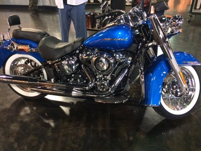 Who doesn't love bright blue? This is the Harley Davidson New Delux. It features… image